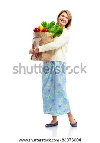 Senior shopping woman with grocery items . Isolated over white background. - stock photo
