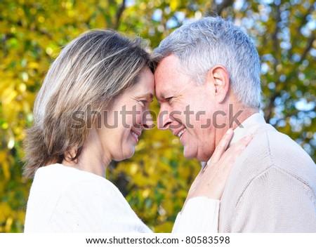 Senior smiling couple in love in park. - stock photo