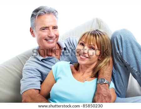Senior smiling couple in love. Isolated over white background. - stock photo