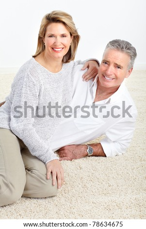 Senior smiling couple in love. Over white background - stock photo