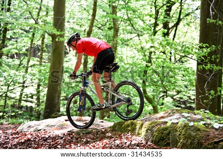 Senior Sporty bike with mountain bike in the woods