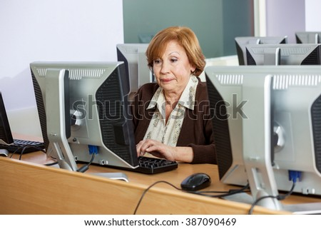 Senior Student Using Desktop PC - stock photo