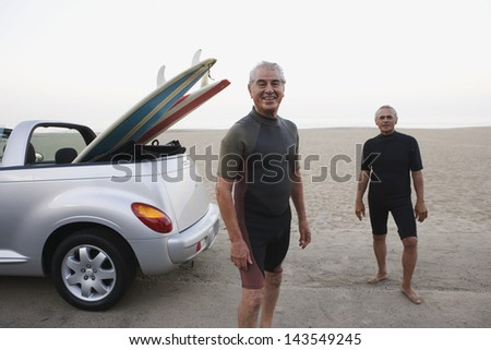 Senior surfers at the beach - stock photo