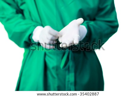 Senior Surgeon putting on his gloves before surgery - stock photo