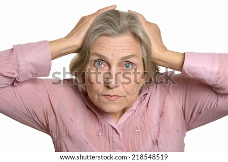 Senior surprised woman isolated on a white background