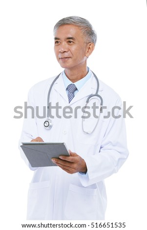 Senior Taiwan medical worker with tablet computer in his hands
