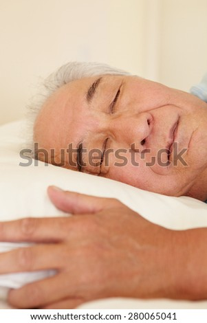 Senior Taiwanese man sleeping