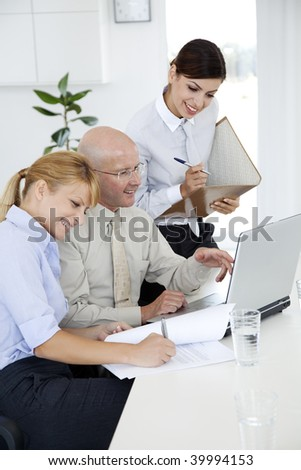 senior teaching younger colleagues - stock photo