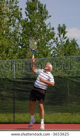 Senior Tennis Player, Serving - stock photo