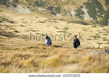 Senior tourist couple hiking at the beautiful mountains, High Tatra Mountains, Poland, Slovakia - stock photo