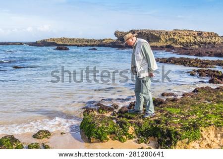 Senior tourist visiting beach in Oualidia, Atlantic coast of Morocco - stock photo