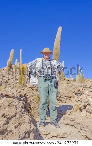 Senior tourist visiting Salar de Uyuni, Bolivia - Isla Incahuasi - stock photo
