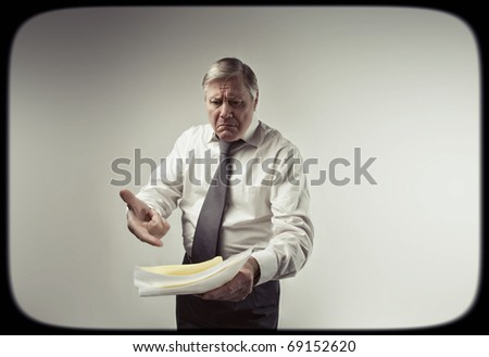 Senior tv announcer on a screen - stock photo