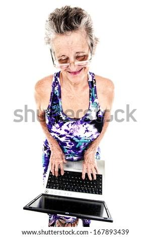 Senior using laptop - stock photo