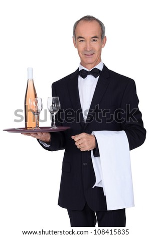 Senior waiter holding tray - stock photo