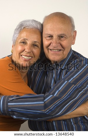 Senior wife and husband hugging each other - stock photo
