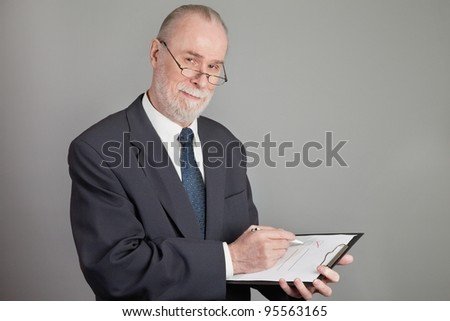 Senior with a checklist on grey background