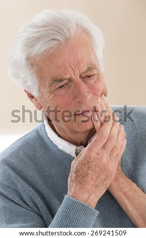senior with cheek soreness or tooth pain