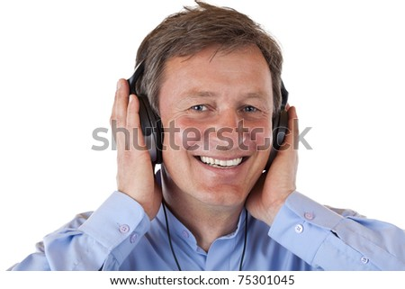 Senior with grey hairs listening with headphones to mp3 music. Isolated on white background. - stock photo