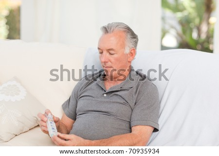 Senior with pills at home