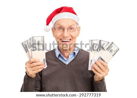 Senior with Santa hat holding six stacks of money and looking at the camera isolated on white background - stock photo