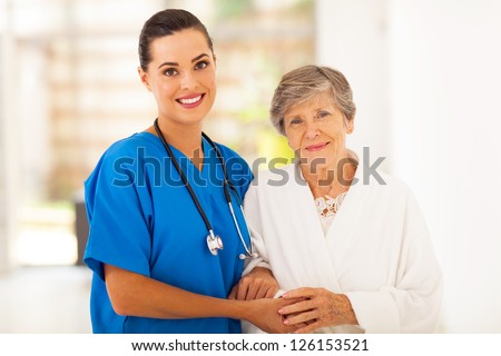 senior woman and caring young nurse - stock photo