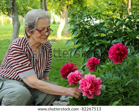 Senior Woman and Flowers - stock photo