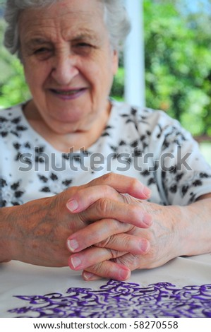 senior woman and her hands - stock photo