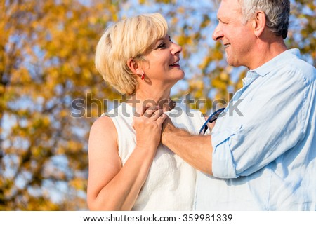 Senior woman and man, couple, embracing each other