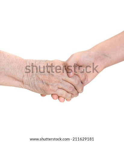Senior woman and young girl  holding hands