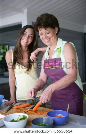 Senior woman and young woman cooking - stock photo