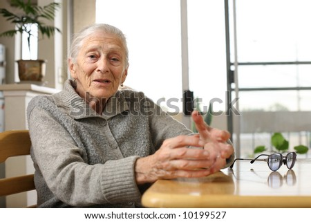 Senior woman at home - stock photo
