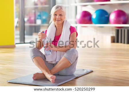 Senior woman at the gym