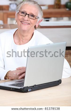 senior woman buys online - stock photo