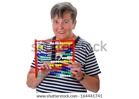 Senior woman calculating on abacus - isolated studio shot - stock photo
