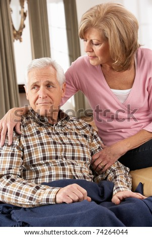Senior Woman Caring For Sick Husband - stock photo