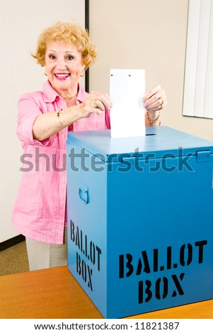 Senior woman casting her vote in the election. - stock photo