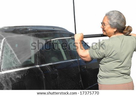 senior woman cleaning her car isolated in white