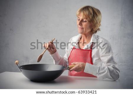 Senior woman cooking - stock photo