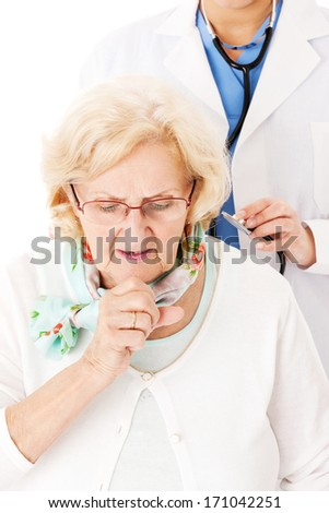 Senior woman coughing while female doctor examining her over white background - stock photo