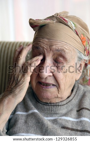 senior woman crying indoor - stock photo