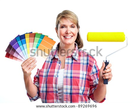 Senior woman doing renovation at home. Painter. - stock photo