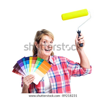 Senior woman doing renowation at home. Painter. - stock photo