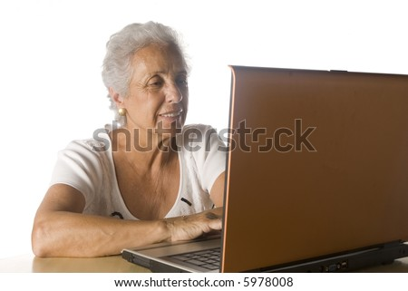senior woman doing research on-line. - stock photo