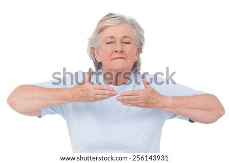 Senior woman doing yoga exercise on white background - stock photo