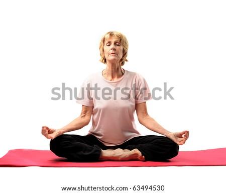Senior woman doing yoga exercises - stock photo