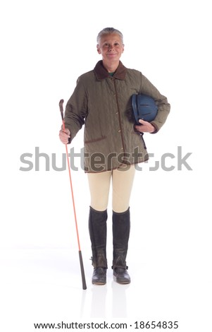 senior woman dressed in english horse riding attire