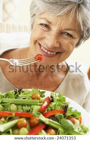 Senior Woman Eating Healthy Salad - stock photo