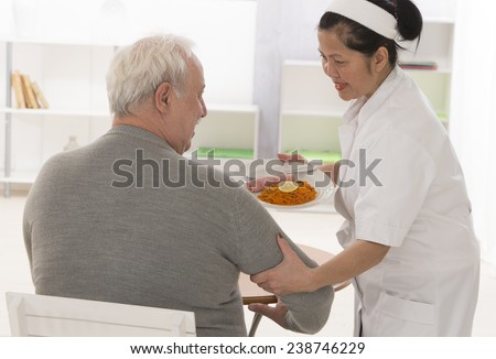 Senior woman eats lunch at retirement home (care, home, elderly) - stock photo