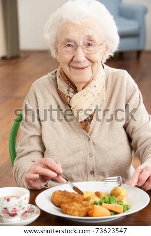 Senior Woman Enjoying Meal - stock photo